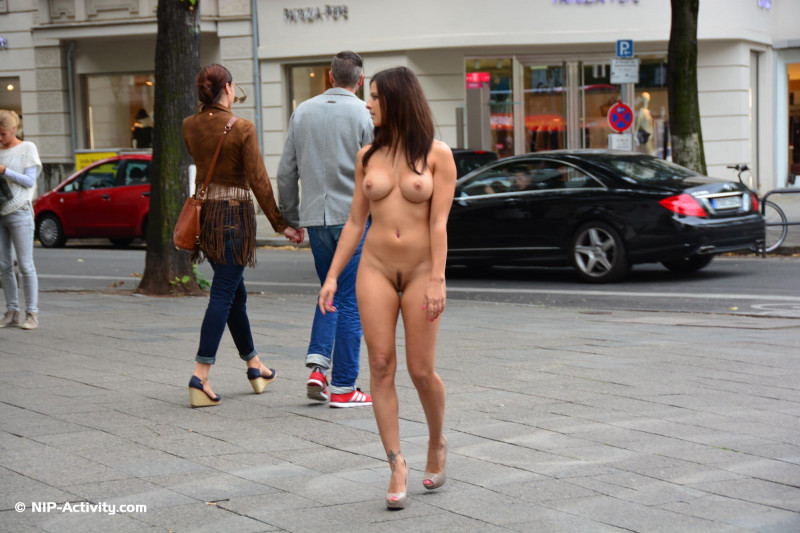 German girl with a perfect body and hairy pussy nude in the high street