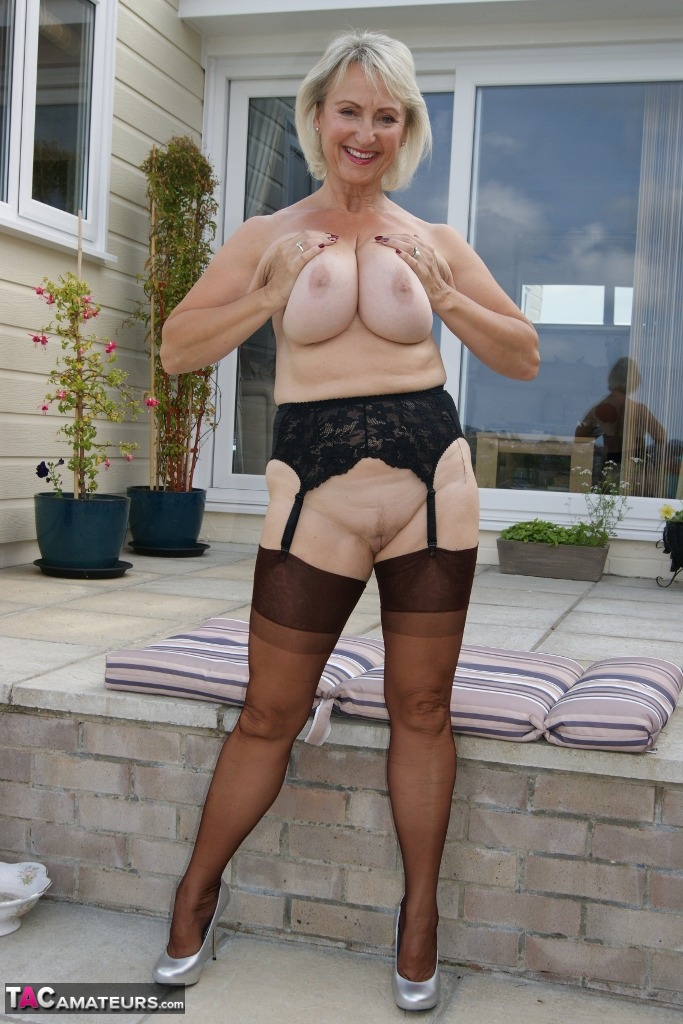 Busty granny Michelle drops her knickers and fingers herself outside